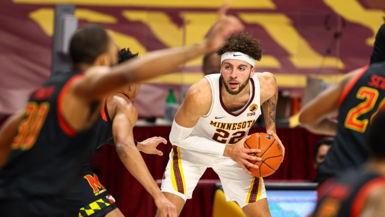 Jan 23, 2021; Minneapolis, Minnesota, USA; Minnesota Gophers guard Gabe Kalscheur (22) looks to passes the ball during the second half against the Maryland Terrapins at Williams Arena. Mandatory Credit: Harrison Barden-USA TODAY Sports