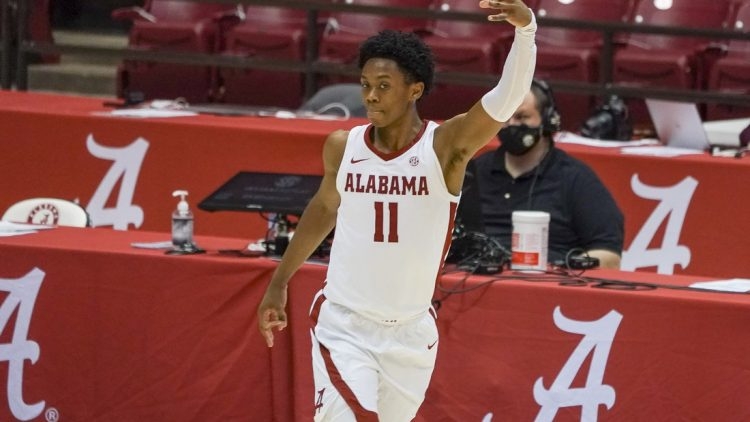 Jan 23, 2021; Tuscaloosa, Alabama, USA; Alabama Crimson Tide guard Joshua Primo (11) reacts after making a three point basket against the Mississippi State Bulldogs during the first half at Coleman Coliseum. Mandatory Credit: Marvin Gentry-USA TODAY Sports