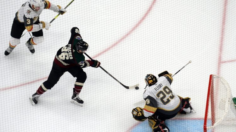 Jan 24, 2021; Glendale, Arizona, USA; Vegas Golden Knights goaltender Marc-Andre Fleury (29) makes a save against Arizona Coyotes right wing Christian Fischer (36) during the third period at Gila River Arena. Mandatory Credit: Joe Camporeale-USA TODAY Sports