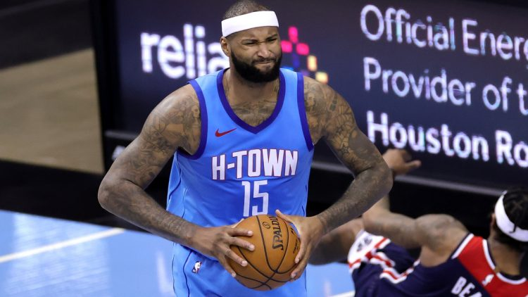 Jan 26, 2021; Houston, Texas, USA; Houston Rockets center DeMarcus Cousins (15) reacts after grabbing an offensive rebound against the Washington Wizards during the third quarter  at Toyota Center. Mandatory Credit: Carmen Mandato/Pool Photo-USA TODAY Sports
