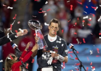 Feb 7, 2021; Tampa, FL, USA;  Confetti falls as Tampa Bay Buccaneers quarterback Tom Brady (12) celebrates with the Vince Lombardi Trophy after beating the Kansas City Chiefs in Super Bowl LV at Raymond James Stadium.  Mandatory Credit: Mark J. Rebilas-USA TODAY Sports