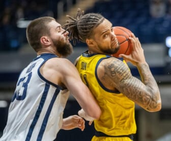 Butler Bulldogs forward Bryce Golden (33) defends Marquette Golden Eagles forward Theo John (4), Wednesday, Feb. 17, 2021, during Marquette at Butler men's basketball from Hinkle Fieldhouse, Indianapolis. Marquette won 73-57.  Butler Takes On Marquette In Men S Hoops