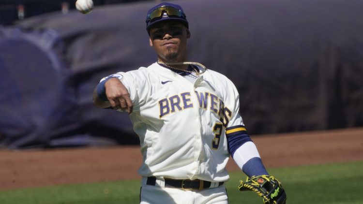 Mar 6, 2021; Phoenix, Arizona, USA; Milwaukee Brewers shortstop Orlando Arcia (3) warms up before a spring training game against the Chicago Cubs at American Family Fields of Phoenix. Mandatory Credit: Rick Scuteri-USA TODAY Sports