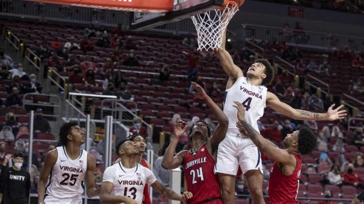 Mar 6, 2021; Louisville, KY, USA; Virginia player Justin McKoy dunks during the second half as the Louisville Cardinals took on the Virginia Cavaliers at the KFC Yum! Center. Mandatory Credit: Alton Strupp-USA TODAY Sports