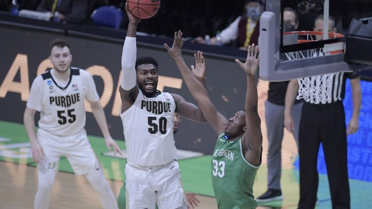 Purdue Boilermakers forward Trevion Williams (50) drives to the basket during the first round of the 2021 NCAA Basketball Tournament at Lucas Oil Stadium Friday evening, March 19, 2021. Mandatory Credit: Denny Simmons/IndyStar via USA TODAY Sports