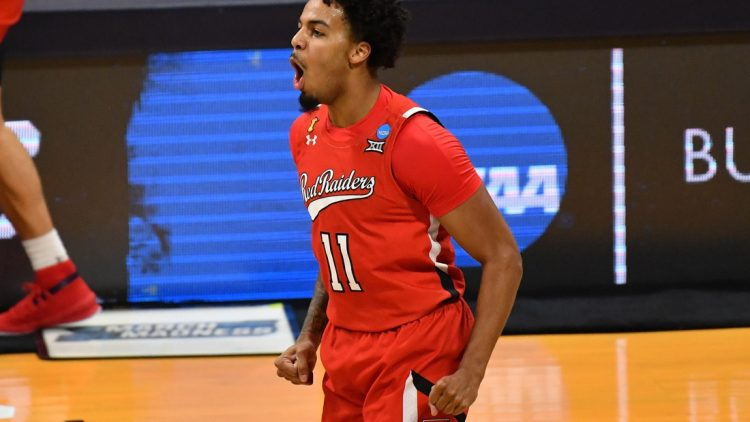 Mar 21, 2021; Indianapolis, Indiana, USA; Texas Tech Red Raiders guard Kyler Edwards (11) reacts after a three pointer in the first half against the Arkansas Razorbacks in the second round of the 2021 NCAA Tournament at Hinkle Fieldhouse. Mandatory Credit: Patrick Gorski-USA TODAY Sports