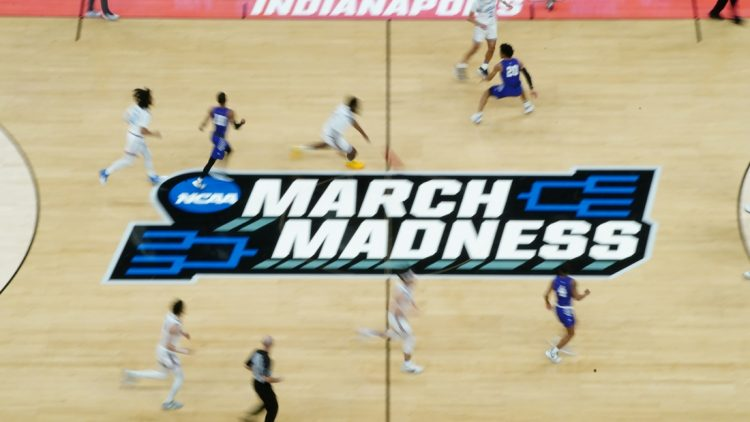 Mar 22, 2021; Indianapolis, Indiana, USA; General view of the March madness logo during the game between the UCLA Bruins and the Abilene Christian Wildcats in the second round of the 2021 NCAA Tournament at Bankers Life Fieldhouse. Mandatory Credit: Kirby Lee-USA TODAY Sports
