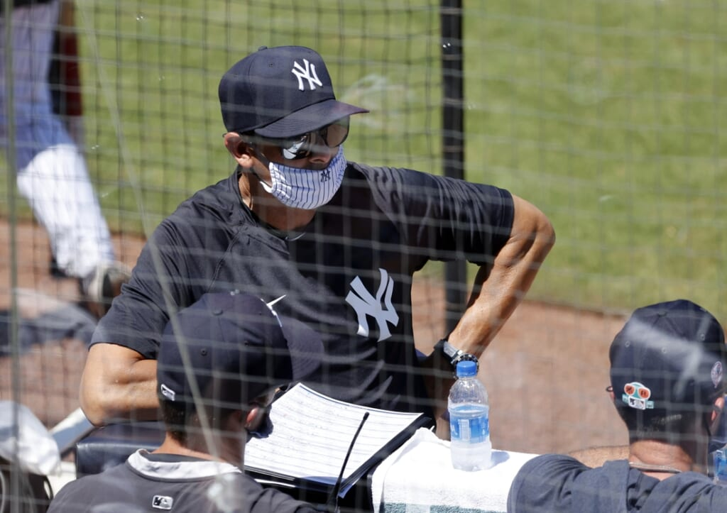 Mar 24, 2021; Tampa, Florida, USA; New York Yankees manager Aaron Boone (17) looks on against the Toronto Blue Jays at George M. Steinbrenner Field. Mandatory Credit: Kim Klement-USA TODAY Sports