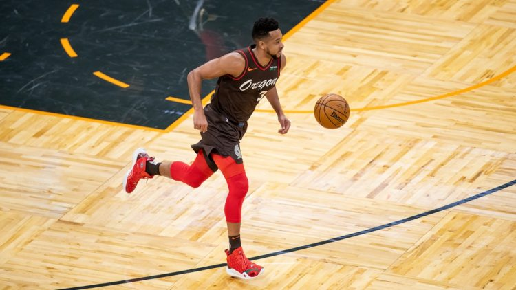 Mar 26, 2021; Orlando, Florida, USA; Portland Trail Blazers guard CJ McCollum (3) dribbles against the Orlando Magic during the first quarter at Amway Center. Mandatory Credit: Mary Holt-USA TODAY Sports