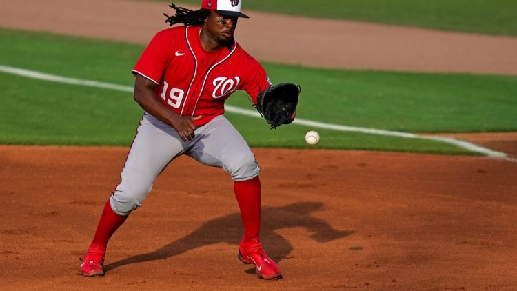 Mar 26, 2021; Port St. Lucie, Florida, USA; Washington Nationals first baseman Josh Bell (19) fields the ground ball before putting out New York Mets center fielder Brandon Nimmo (9, not pictured) in the 1st inning of the spring training game at Clover Park. Mandatory Credit: Jasen Vinlove-USA TODAY Sports