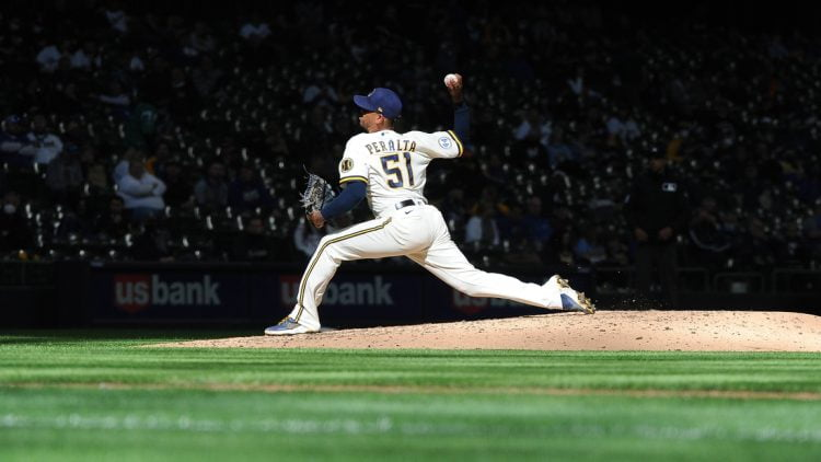 Apr 1, 2021; Milwaukee, Wisconsin, USA; Milwaukee Brewers relief pitcher Freddy Peralta (51) delivers a pitch against the Minnesota Twins in the sixth inning at American Family Field. Mandatory Credit: Michael McLoone-USA TODAY Sports