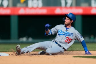 Apr 1, 2021; Denver, Colorado, USA; Los Angeles Dodgers center fielder Cody Bellinger (35) slides safely in to second on a double in the fifth inning against the Colorado Rockies at Coors Field. Mandatory Credit: Isaiah J. Downing-USA TODAY Sports