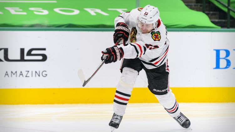 Mar 11, 2021; Dallas, Texas, USA; Chicago Blackhawks center Mattias Janmark (13) in action during the game between the Dallas Stars and the Chicago Blackhawks at the American Airlines Center. Mandatory Credit: Jerome Miron-USA TODAY Sports