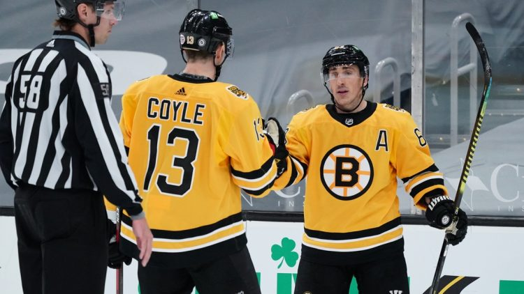 Apr 3, 2021; Boston, Massachusetts, USA; Boston Bruins center Brad Marchand (63) is congratulated by center Charlie Coyle (13) after scoring his third goal of the game against the Pittsburgh Penguins in the third period at TD Garden. Mandatory Credit: David Butler II-USA TODAY Sports