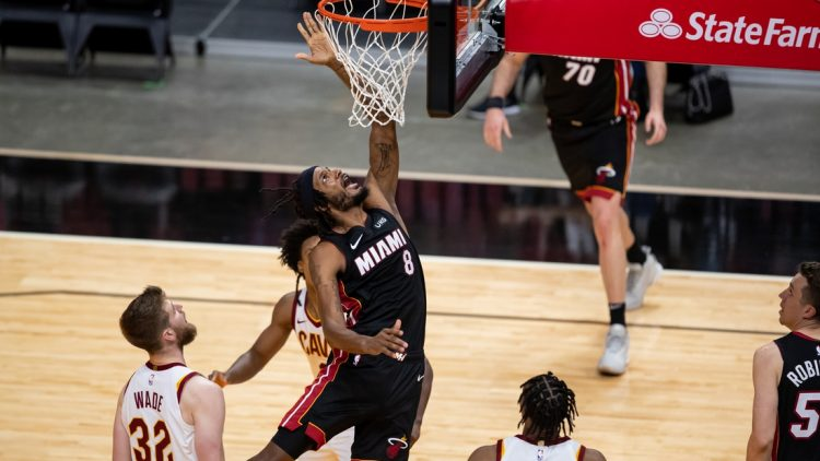 Apr 3, 2021; Miami, Florida, USA; Miami Heat forward Trevor Ariza (8) attempts a layup during the fourth quarter of a game against the Cleveland Cavaliers at American Airlines Arena. Mandatory Credit: Mary Holt-USA TODAY Sports