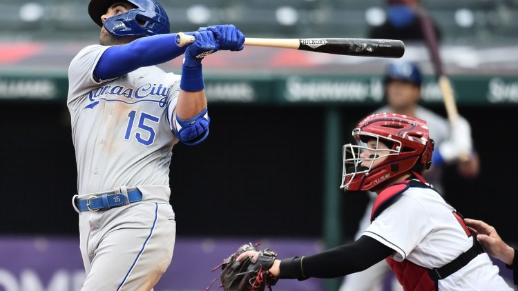 Apr 5, 2021; Cleveland, Ohio, USA; Kansas City Royals second baseman Whit Merrifield (15) hits a sacrifice fly during the seventh inning against the Cleveland Indians at Progressive Field. Mandatory Credit: Ken Blaze-USA TODAY Sports