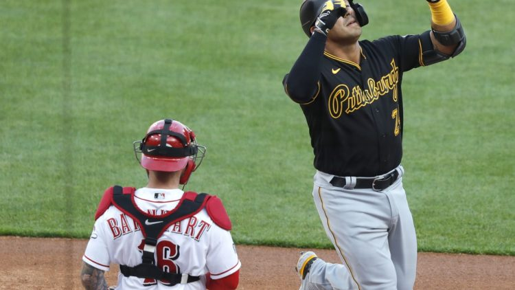 Apr 5, 2021; Cincinnati, Ohio, USA; Pittsburgh Pirates third baseman Phillip Evans (24) reacts after hitting a solo home run against the Cincinnati Reds during the first inning at Great American Ball Park. Mandatory Credit: David Kohl-USA TODAY Sports