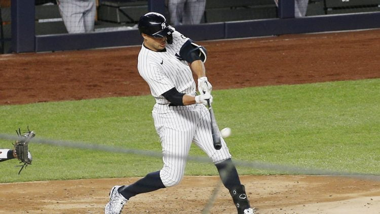 Apr 5, 2021; Bronx, New York, USA; New York Yankees designated hitter Giancarlo Stanton (27) hits a grand slam home run against the Baltimore Orioles during the fifth inning at Yankee Stadium. Mandatory Credit: Andy Marlin-USA TODAY Sports