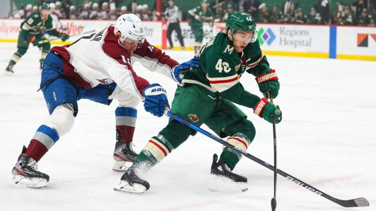 Apr 5, 2021; Saint Paul, Minnesota, USA; Colorado Avalanche right wing Valeri Nichushkin (13) and Minnesota Wild defenseman Jared Spurgeon (46) fight for the puck during the first period at Xcel Energy Center. Mandatory Credit: Harrison Barden-USA TODAY Sports