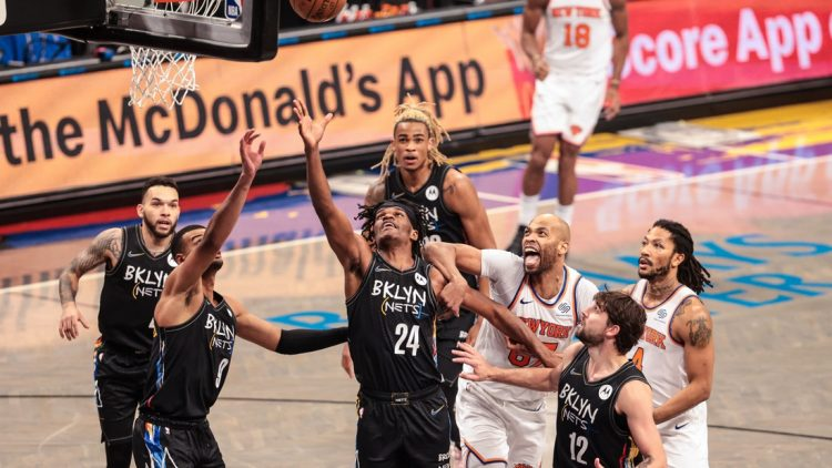 Apr 5, 2021; Brooklyn, New York, USA; Brooklyn Nets forward Alize Johnson (24) and guard Timothe Luwawu-Cabarrot (9) rebounds against New York Knicks center Taj Gibson (67) during the second half at Barclays Center. Mandatory Credit: Vincent Carchietta-USA TODAY Sports