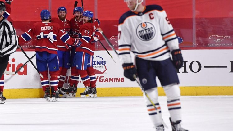 Apr 5, 2021; Montreal, Quebec, CAN; Montreal Canadiens forward Eric Staal (21) reacts with teammates including defenseman Jeff Petry (26) and forward Tyler Toffoli (73) and forward Nick Suzuki (14) after scoring the winning goal against the Edmonton Oilers during the overtime period at the Bell Centre. Mandatory Credit: Eric Bolte-USA TODAY Sports
