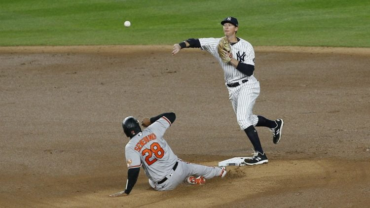 Apr 5, 2021; Bronx, New York, USA; Baltimore Orioles catcher Pedro Severino (28) is forced out at second base by New York Yankees second baseman DJ LeMahieu (right) during the fifth inning at Yankee Stadium. Mandatory Credit: Andy Marlin-USA TODAY Sports