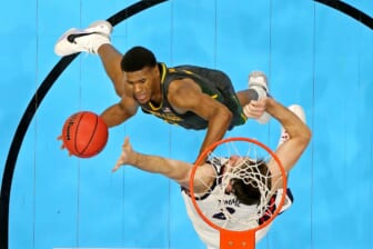 Apr 5, 2021; Indianapolis, IN, USA; Baylor Bears guard Jared Butler (12) shoots the ball against Gonzaga Bulldogs forward Drew Timme (2) during the second half in the national championship game during the Final Four of the 2021 NCAA Tournament at Lucas Oil Stadium. Mandatory Credit: Robert Deutsch-USA TODAY Sports