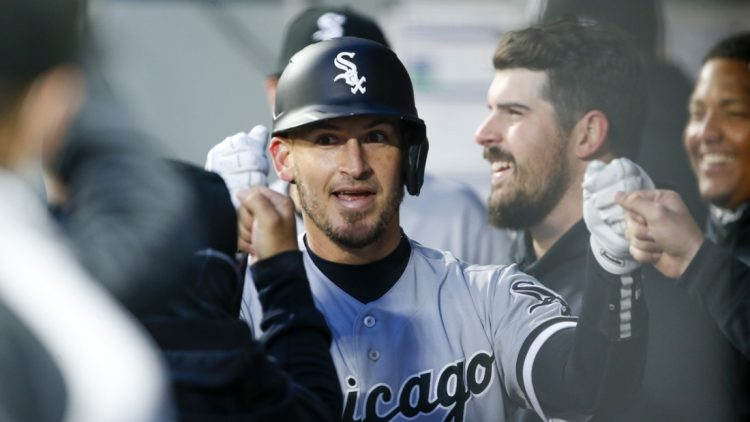 Apr 5, 2021; Seattle, Washington, USA; Chicago White Sox catcher Yasmani Grandal (24) celebrates in the dugout after hitting a solo home run against the Seattle Mariners during the second inning at T-Mobile Park. Mandatory Credit: Joe Nicholson-USA TODAY Sports