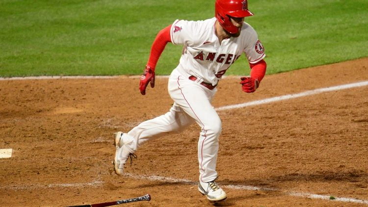Apr 5, 2021; Anaheim, California, USA; Los Angeles Angels first baseman Jared Walsh (20) reaches first on a fielders choice against the Houston Astros during the eighth inning at Angel Stadium. Mandatory Credit: Gary A. Vasquez-USA TODAY Sports