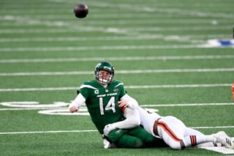 New York Jets quarterback Sam Darnold (14) gets rid of the ball as he's hit by Cleveland Browns defensive tackle Jordan Elliott (90) in the second half. The Jets defeat the Browns, 23-16, at MetLife Stadium on Sunday, Dec. 27, 2020, in East Rutherford.  Nyj Vs Cle