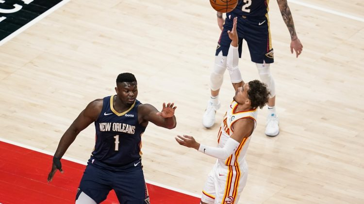 Apr 6, 2021; Atlanta, Georgia, USA; Atlanta Hawks guard Trae Young (11) shoots over New Orleans Pelicans forward Zion Williamson (1) during the first quarter at State Farm Arena. Mandatory Credit: Dale Zanine-USA TODAY Sports