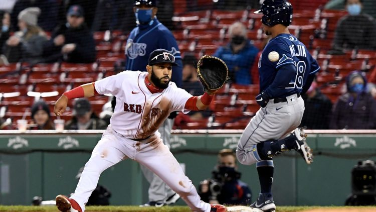 Apr 6, 2021; Boston, Massachusetts, USA; Tampa Bay Rays catcher Francisco Mejia (28) is safe at first base in front of Boston Red Sox first baseman Marwin Gonzalez (12) during the fourth inning at Fenway Park. Mandatory Credit: Brian Fluharty-USA TODAY Sports