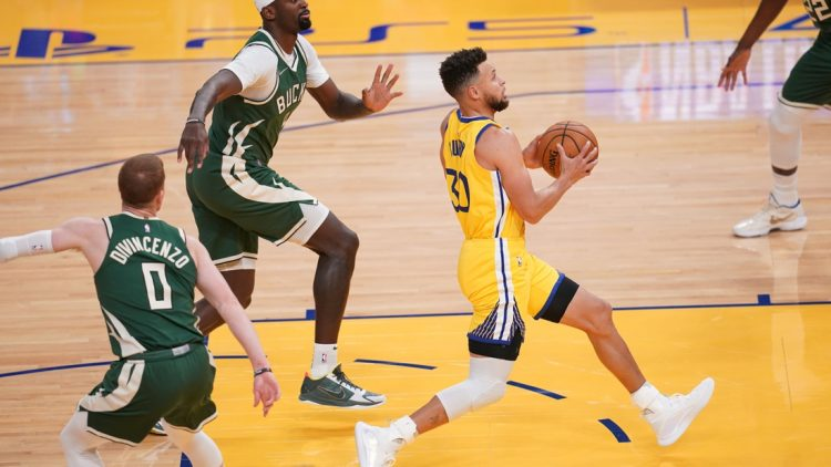 Apr 6, 2021; San Francisco, California, USA; Golden State Warriors guard Stephen Curry (30) drives to the hoop against the Milwaukee Bucks in the first quarter at the Chase Center. Mandatory Credit: Cary Edmondson-USA TODAY Sports