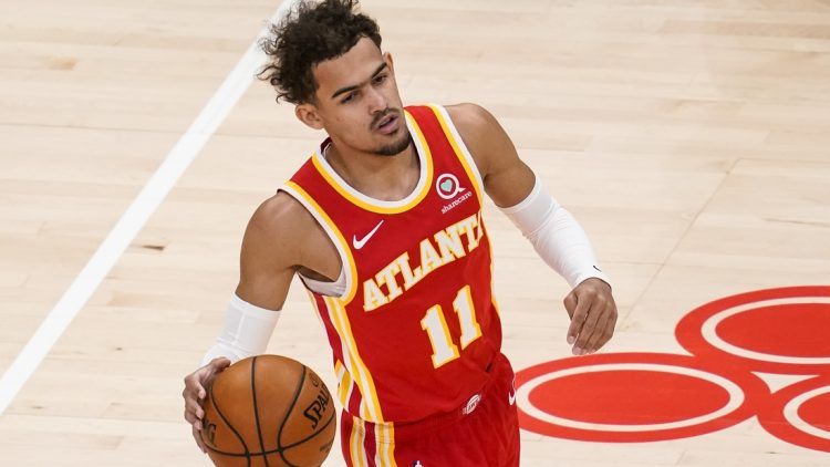 Apr 7, 2021; Atlanta, Georgia, USA; Atlanta Hawks guard Trae Young (11) brings the ball up court against the Memphis Grizzlies during the first half at State Farm Arena. Mandatory Credit: Dale Zanine-USA TODAY Sports