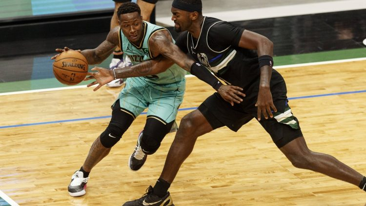 Apr 9, 2021; Milwaukee, Wisconsin, USA; Milwaukee Bucks forward Bobby Portis (9) reaches for the ball controlled by Charlotte Hornets guard Terry Rozier (3)  during the third quarter at Fiserv Forum. Mandatory Credit: Jeff Hanisch-USA TODAY Sports