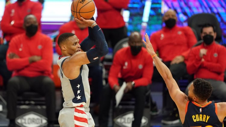 Apr 9, 2021; San Francisco, California, USA; Washington Wizards guard Russell Westbrook (4) shoots over Golden State Warriors guard Stephen Curry (30) during the second quarter at Chase Center. Mandatory Credit: Darren Yamashita-USA TODAY Sports