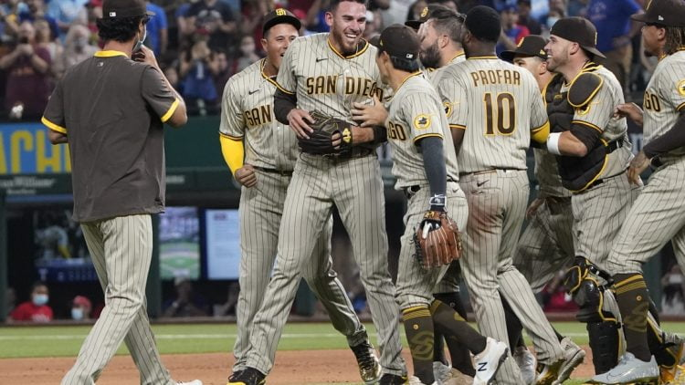 Apr 9, 2021; Arlington, Texas, USA; San Diego Padres starting pitcher Joe Musgrove (middle) celebrates his no hitter with teammates against the Texas Rangers at Globe Life Field. Mandatory Credit: Jim Cowsert-USA TODAY Sports