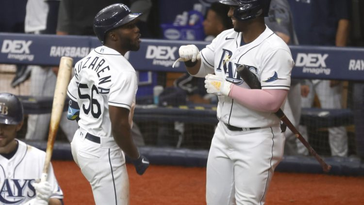 Apr 10, 2021; St. Petersburg, Florida, USA; Tampa Bay Rays left fielder Randy Arozarena (56) is congratulated by  first baseman Yandy D az (R) after hitting a home run during the third inning against the New York Yankees at Tropicana Field. Mandatory Credit: Kim Klement-USA TODAY Sports