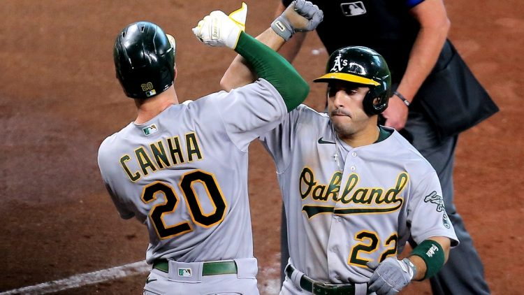 Apr 10, 2021; Houston, Texas, USA; Oakland Athletics center fielder Ramon Laureano (22, right) is congratulated by Oakland Athletics left fielder Mark Canha (20) after hitting a two-run home run against the Houston Astros during the fifth inning at Minute Maid Park. Mandatory Credit: Erik Williams-USA TODAY Sports