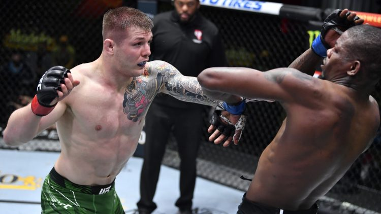 April 10, 2021; Las Vegas, NV, USA;   Marvin Vettori of Italy punches Kevin Holland in a middleweight fight during the UFC Fight Night event at UFC APEX on April 10, 2021 in Las Vegas, Nevada. Mandatory Credit: Chris Unger/Handout Photo via USA TODAY Sports