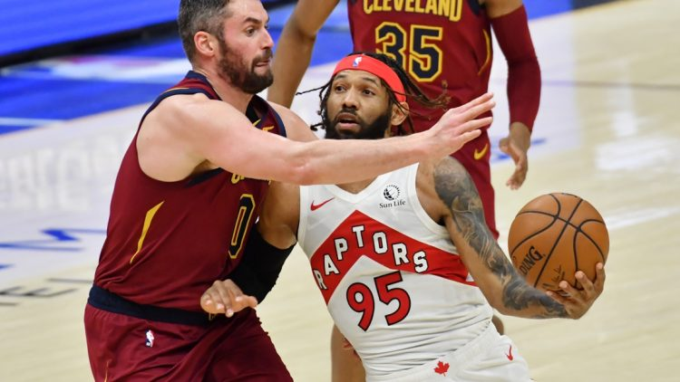 Apr 10, 2021; Cleveland, Ohio, USA; Toronto Raptors guard DeAndre' Bembry (95) moves to the basket against Cleveland Cavaliers forward Kevin Love (0) during the third quarter at Rocket Mortgage FieldHouse. Mandatory Credit: Ken Blaze-USA TODAY Sports