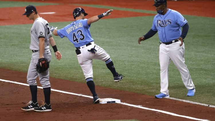 Apr 11, 2021; St. Petersburg, Florida, USA; Tampa Bay Rays third baseman Mike Brosseau (43) singles during the second inning against the New York Yankees at Tropicana Field. Mandatory Credit: Kim Klement-USA TODAY Sports