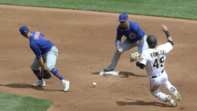 Apr 11, 2021; Pittsburgh, Pennsylvania, USA;  Chicago Cubs second baseman Eric Sogard (4) flips the ball between his legs to shortstop Javier Baez (9) for a forceout of Pittsburgh Pirates center fielder Dustin Fowler (49) at second base during the third inning at PNC Park. Mandatory Credit: Charles LeClaire-USA TODAY Sports