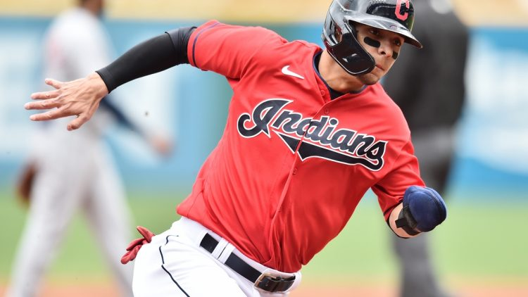 Apr 11, 2021; Cleveland, Ohio, USA; Cleveland Indians shortstop Andres Gimenez (0) rounds third base en route to scoring during the third inning against the Detroit Tigers at Progressive Field. Mandatory Credit: Ken Blaze-USA TODAY Sports