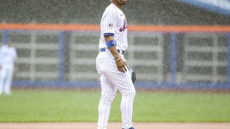 Apr 11, 2021; New York City, New York, USA; New York Mets shortstop Francisco Lindor (12) takes the field in the top of the first inning against the Miami Marlins prior to a rain delay at Citi Field. Mandatory Credit: Wendell Cruz-USA TODAY Sports