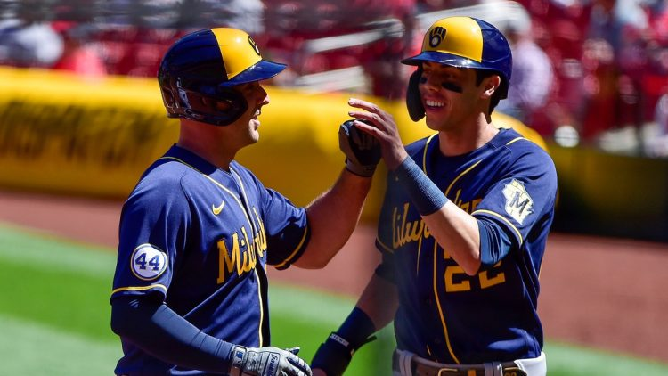 Apr 11, 2021; St. Louis, Missouri, USA;  Milwaukee Brewers third baseman Travis Shaw (21) celebrates with left fielder Christian Yelich (22) after hitting a three run home run off of St. Louis Cardinals starting pitcher Daniel Ponce de Leon (not pictured) during the second inning at Busch Stadium. Mandatory Credit: Jeff Curry-USA TODAY Sports