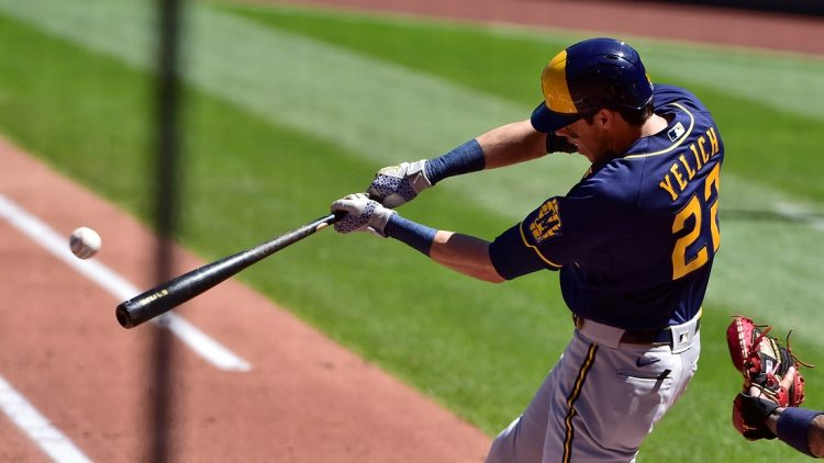 Apr 11, 2021; St. Louis, Missouri, USA;  Milwaukee Brewers left fielder Christian Yelich (22) hits a single off of St. Louis Cardinals starting pitcher Daniel Ponce de Leon (not pictured) during the second inning at Busch Stadium. Mandatory Credit: Jeff Curry-USA TODAY Sports