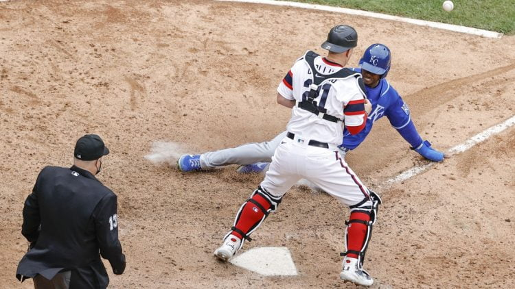 Apr 11, 2021; Chicago, Illinois, USA; Kansas City Royals center fielder Michael A. Taylor (2) scores as Chicago White Sox catcher Zack Collins (21) is unable to tag him out during the tenth inning at Guaranteed Rate Field. Mandatory Credit: Kamil Krzaczynski-USA TODAY Sports