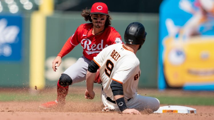 Apr 14, 2021; San Francisco, California, USA; San Francisco Giants first baseman Brandon Belt (9) is caught stealing second base by Cincinnati Reds second baseman Jonathan India (6) during the sixth inning at Oracle Park. Mandatory Credit: Neville E. Guard-USA TODAY Sports