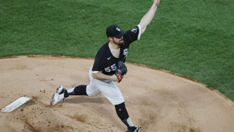 Apr 14, 2021; Chicago, Illinois, USA; Chicago White Sox starting pitcher Carlos Rodon (55) delivers against the Cleveland Indians during the first inning at Guaranteed Rate Field. Mandatory Credit: Kamil Krzaczynski-USA TODAY Sports